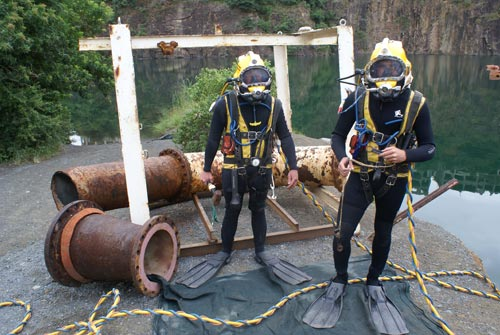 Commercial diving students with tasks at quarry dive site